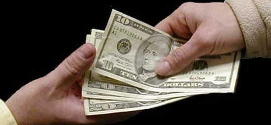 Image of money changing hands alt text